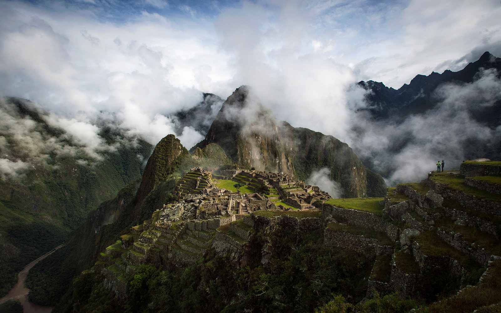 MACHU PICCHU, PERU - JANUARY 18: The Inca ruins of the Machu Picchu sanctuary on January 18, 2014 near Cusco, Peru. The 15th-century Inca site, MachuPicchu also known as 'The Lost City of the Incas' is situated high above the Urubamba River. Now a UNESCO
