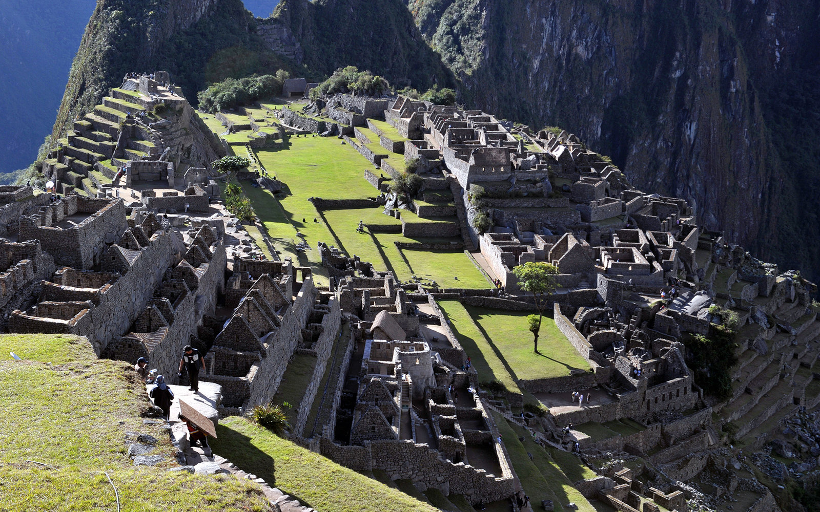 Tourists walk among the ruins of the Machu Picchu citadel, 130 km northwest of Cusco, Peru on July 6, 2011. The Inca compound is being prepared for the centennial commemoration of its discovery by American adventurer and archaeologist Hiram Bingham in 191