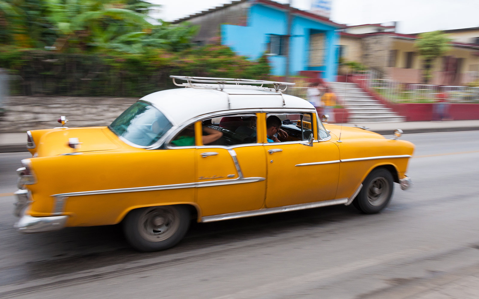 SANTA CLARA, VILLA CLARA, CUBA - 2012/04/28: An old fashioned yellow taxi on the street of Cuba. Cuba still has many American cars of the 1950s running on the roads. (Photo by Roberto Machado Noa/LightRocket via Getty Images)