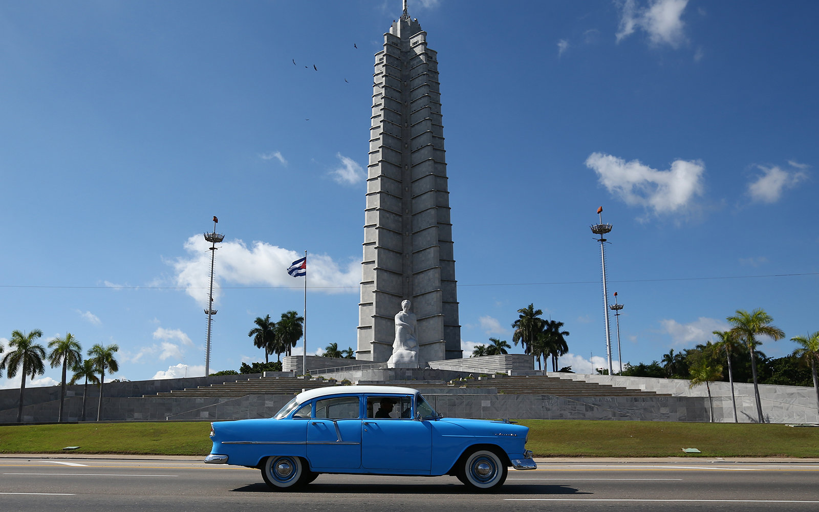 HAVANA, CUBA - SEPTEMBER 18: A vintage American car is driven past the Jose Marti Memorial in Revolution Square where Pope Francis will perform Mass during his visit to Havana, on September 18, 2015 in Havana, Cuba. Pope Francis is due to make a three day
