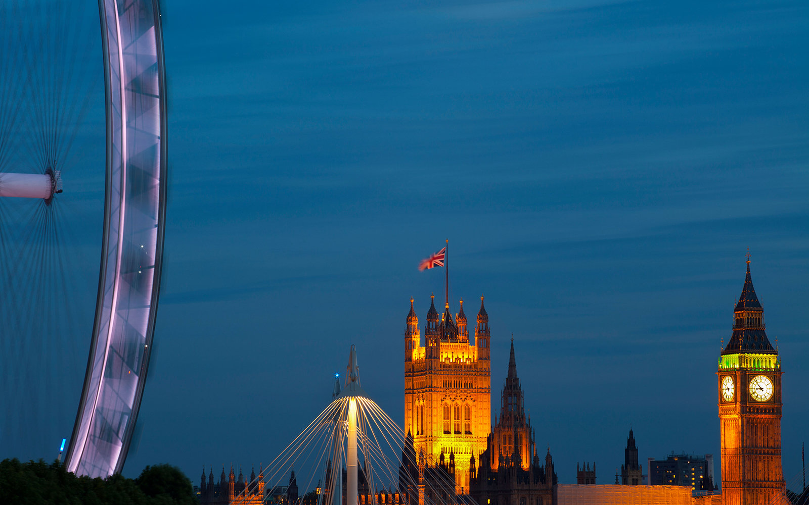 BP68HC Millennium wheel and Houses of Parliament at dusk, London, UK.