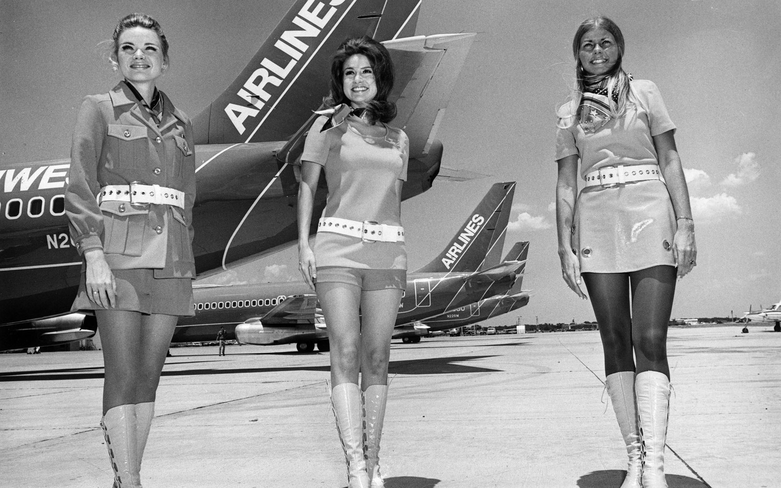 circa 1968:  Stewardesses on Southwest Airlines in Texas stand in front of planes belonging to the airline.  (Photo by Alan Band/Keystone/Getty Images)