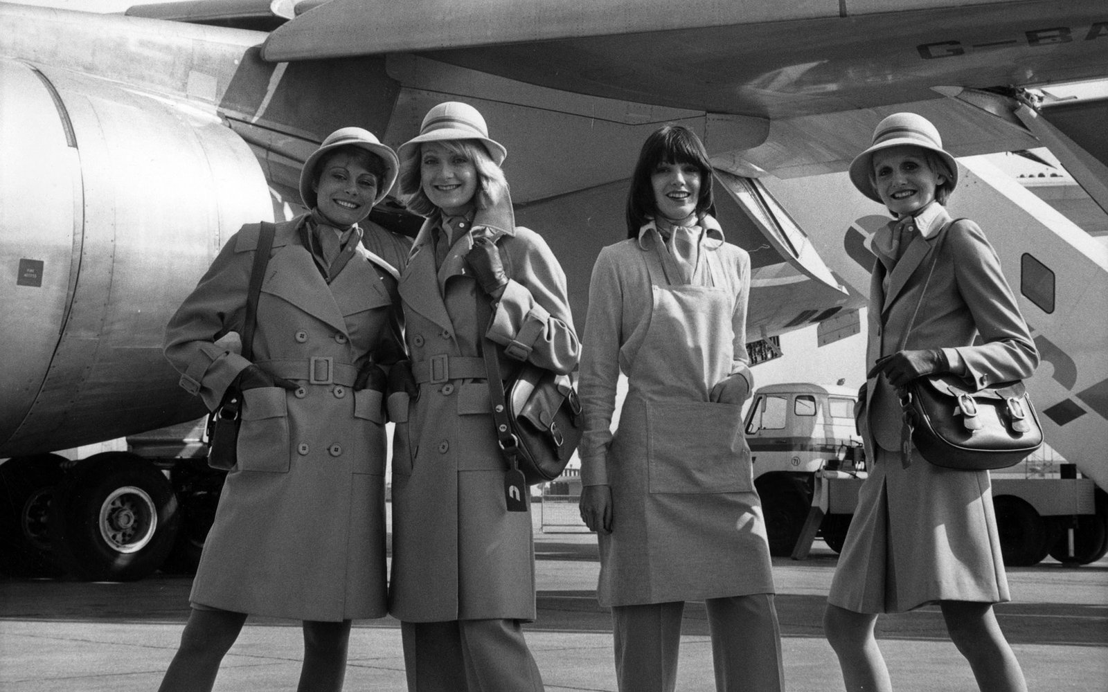 22nd March 1973:  A group of air hostesses model the new uniforms designed by Mary Quant for the stewardesses of Court Line Aviation. The fashion show takes place at Luton airport, in front of one of the airline's fleet of new Lockheed Tristar passenger a
