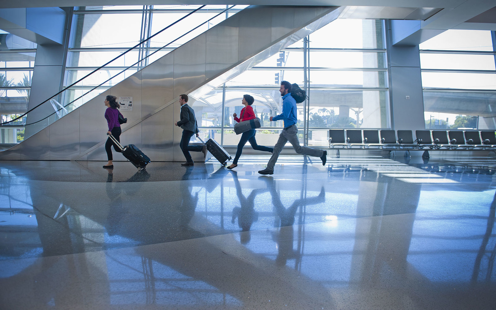young businessmen/women rushing through airport