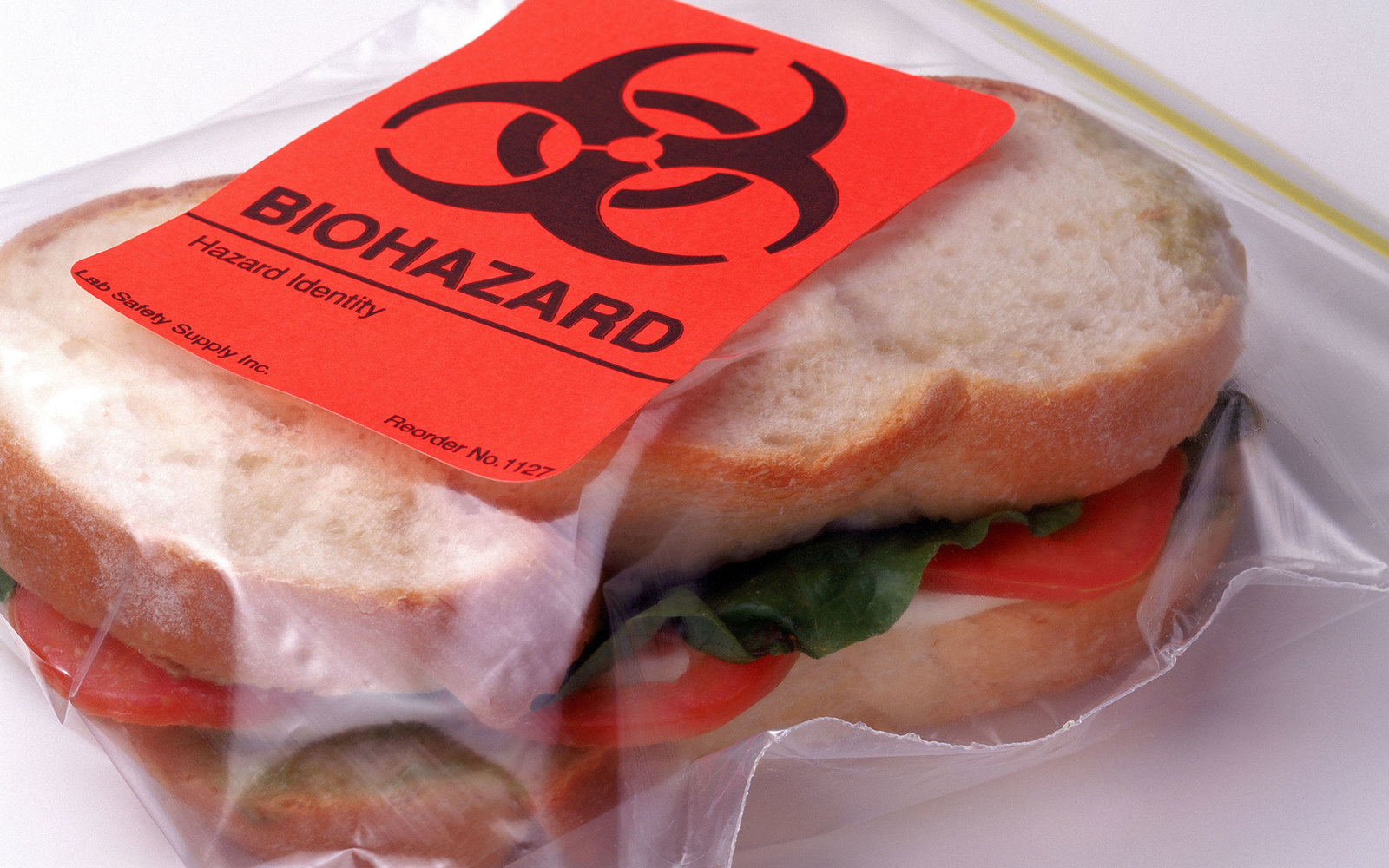 Sandwich in plastic bag with biohazard sticker