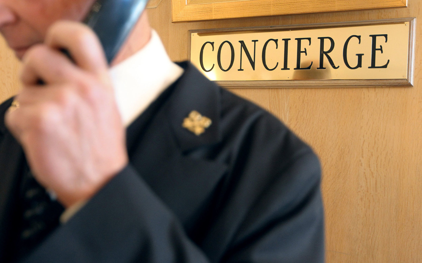 A concierge of a luxury hotel takes a reservation on January 4, 2013 in Cannes, southeastern France.  AFP PHOTO / JEAN CHRISTOPHE MAGNENET        (Photo credit should read JEAN CHRISTOPHE MAGNENET/AFP/Getty Images)
