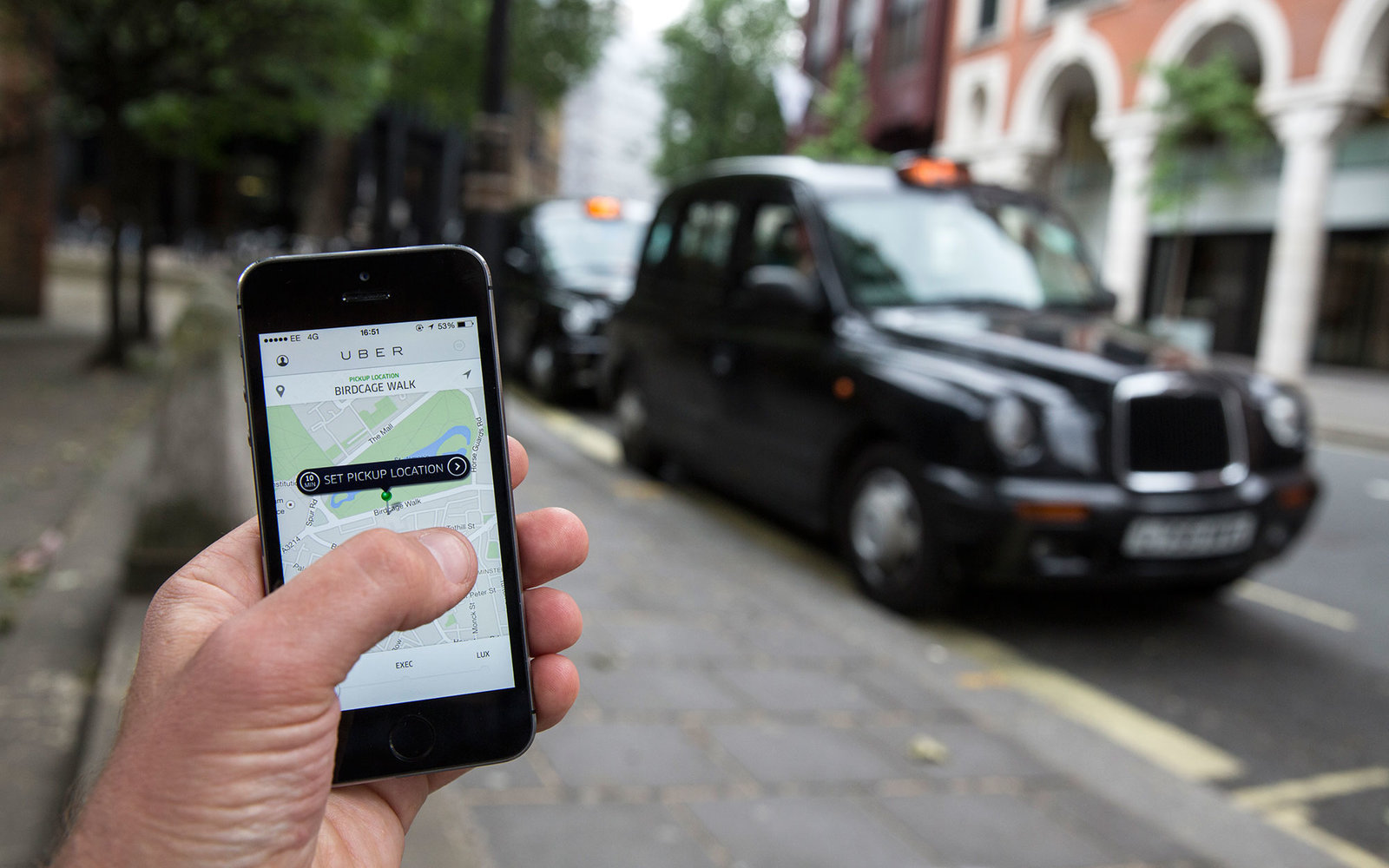 LONDON, ENGLAND - JUNE 02: In this photo illustration, a smartphone displays the 'Uber' mobile application which allows users to hail private-hire cars from any location on June 2, 2014 in London, England.