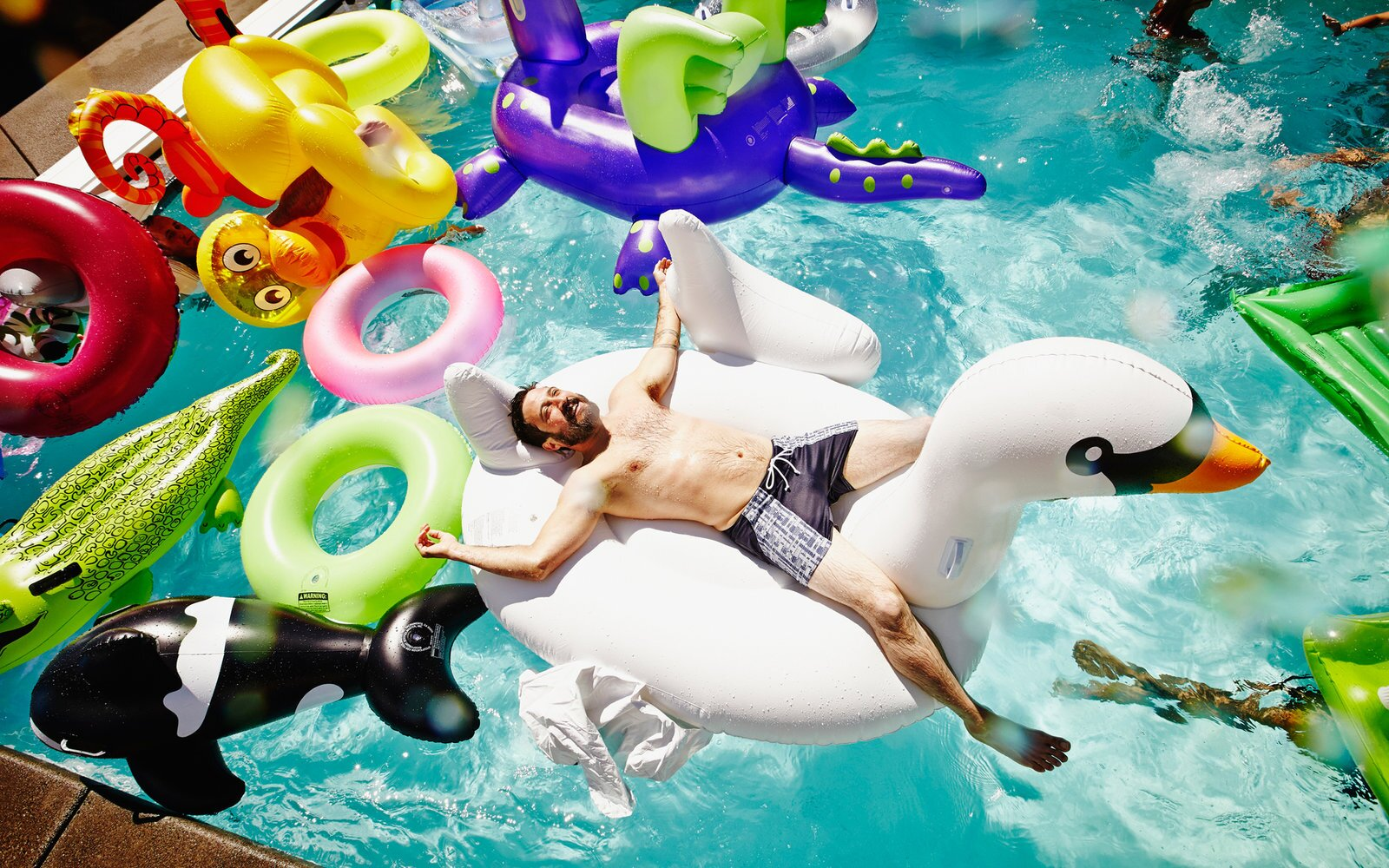 68782c612d 23 Best Pool Floats - Unicorns, Swans, Donuts + More | Travel + Leisure