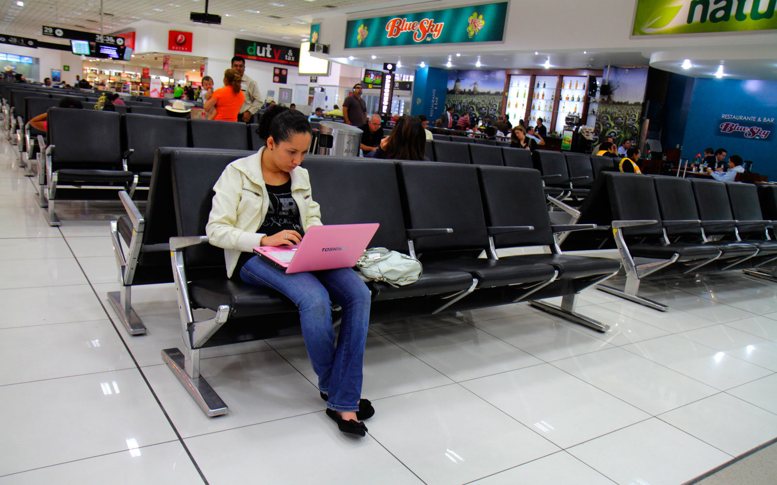 woman with laptop in airport