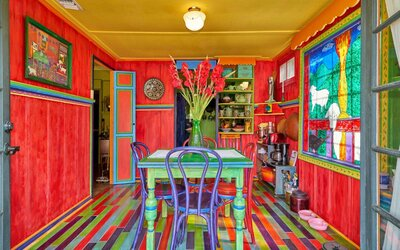 Palm Springs' Most Colorful Cottage Is for Sale, Just in ... on patriotic home design, arch home design, river home design, tree home design, glow home design, pinks home design, europe home design, neutral color home design, bohemian home design, rabbit home design, grey home design, tornado home design, bad home design, glam home design, asia home design, horizon home design,