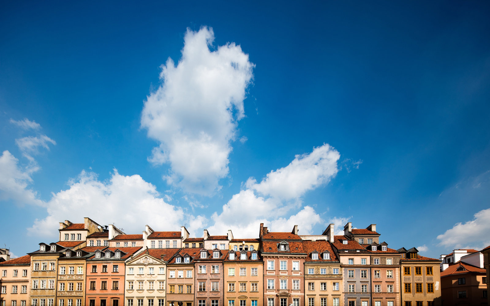 Warsaw's Old Town against a summer sky.