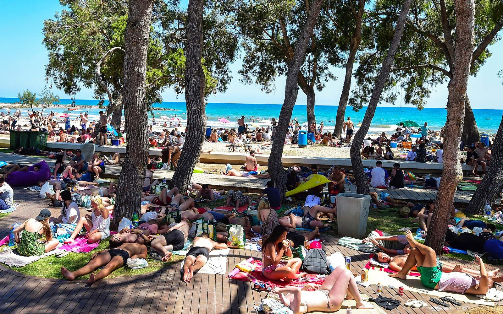 Revellers sleep on the grass near a beach on the fourth and last day of the Benicassim International Festival in Benicassim, in Castellon province, Spain