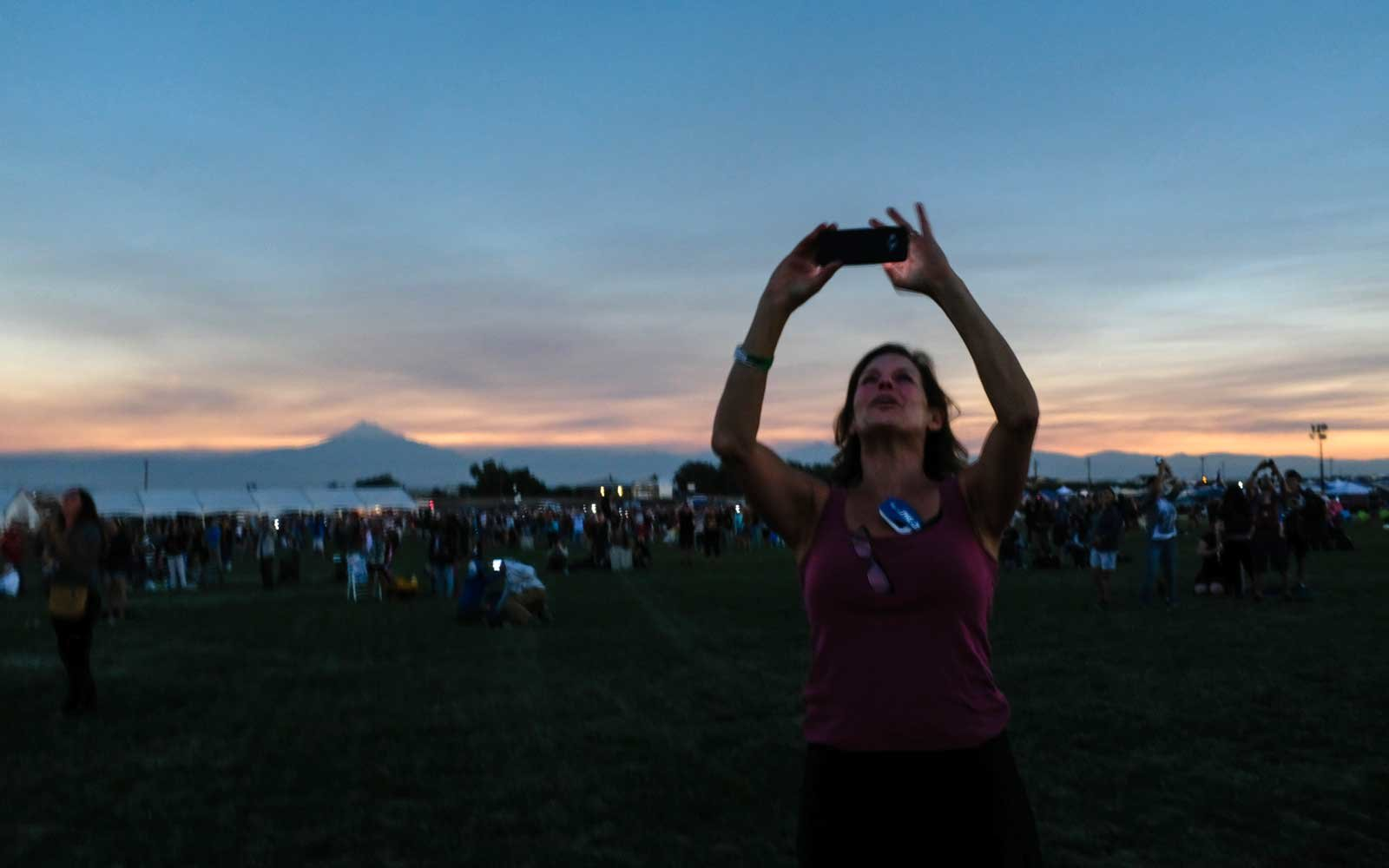 Barbara Hintzen of Edmonds, Washington records the sun during totality on August 21, 2017 in Madras, Oregon.