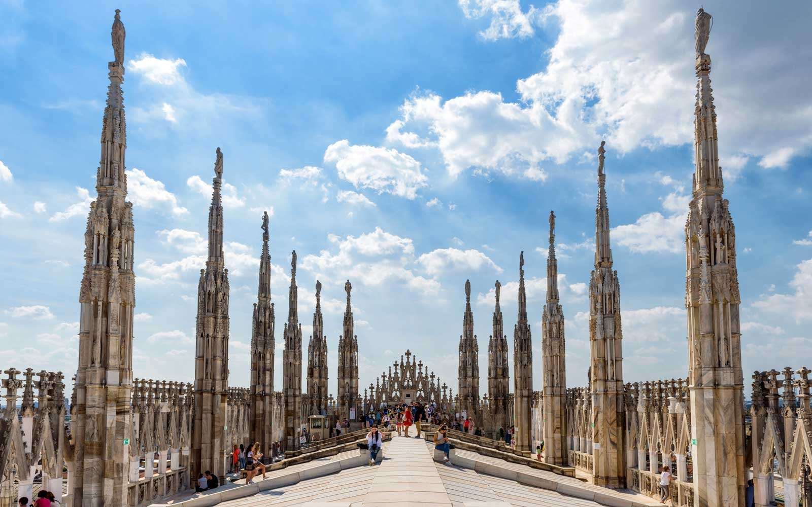 Tourists visit the roof of the Milan Cathedral (Duomo di Milano).