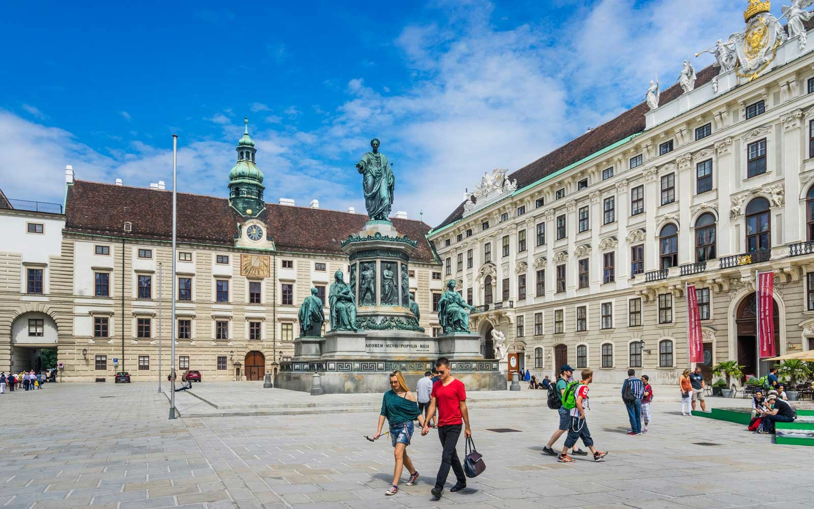 Monument to Emperor Francis at the internal Castle square against the backdrop of the Amalia Residence and Imperial Chancellery Wing, Vienna, Austria