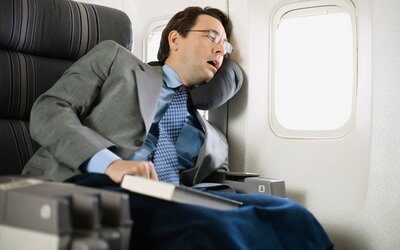 You've Been Sleeping on Planes All Wrong | Travel + Leisure