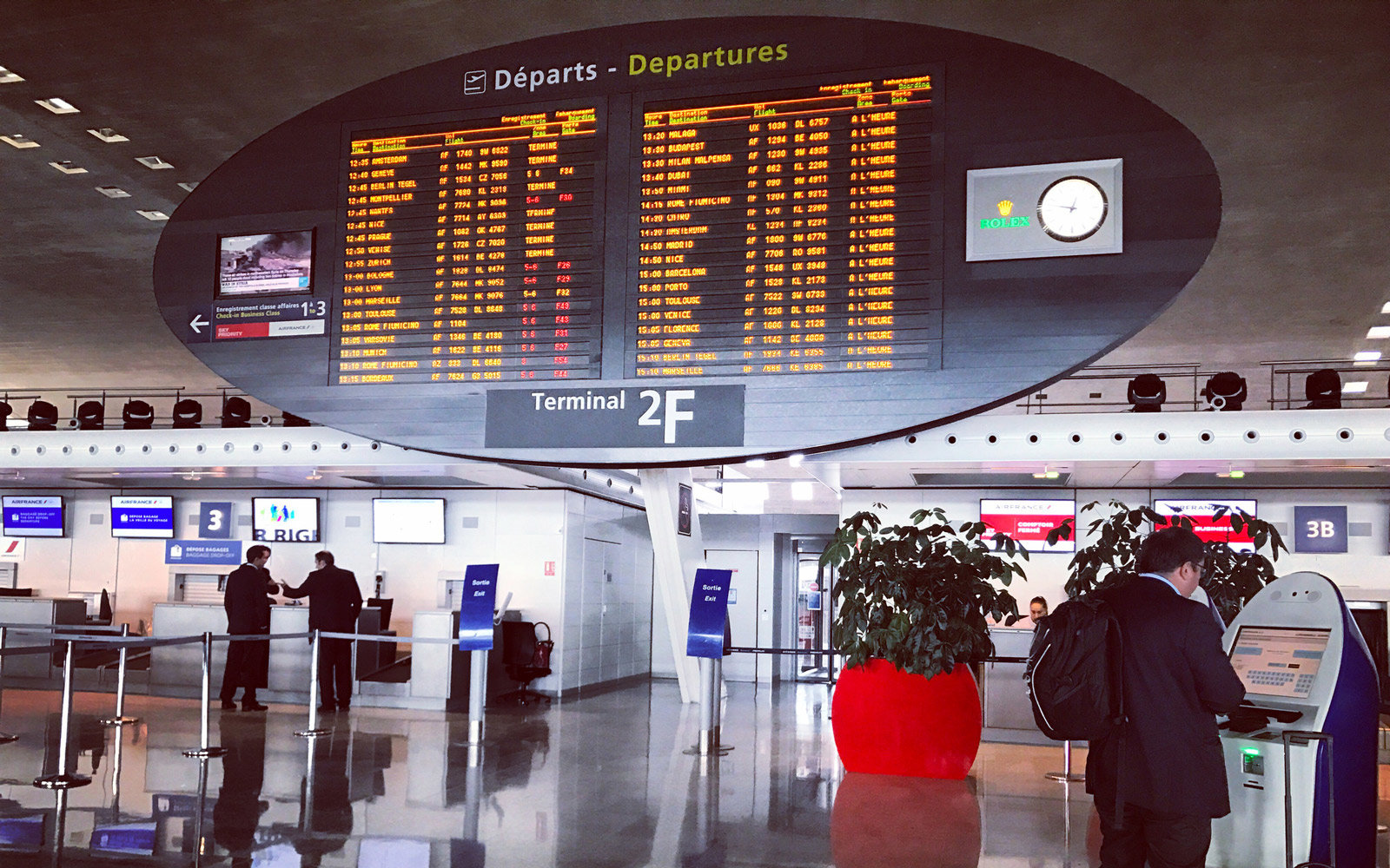 People traveling through Roissy Charles de Gaulle Airport, Paris, France