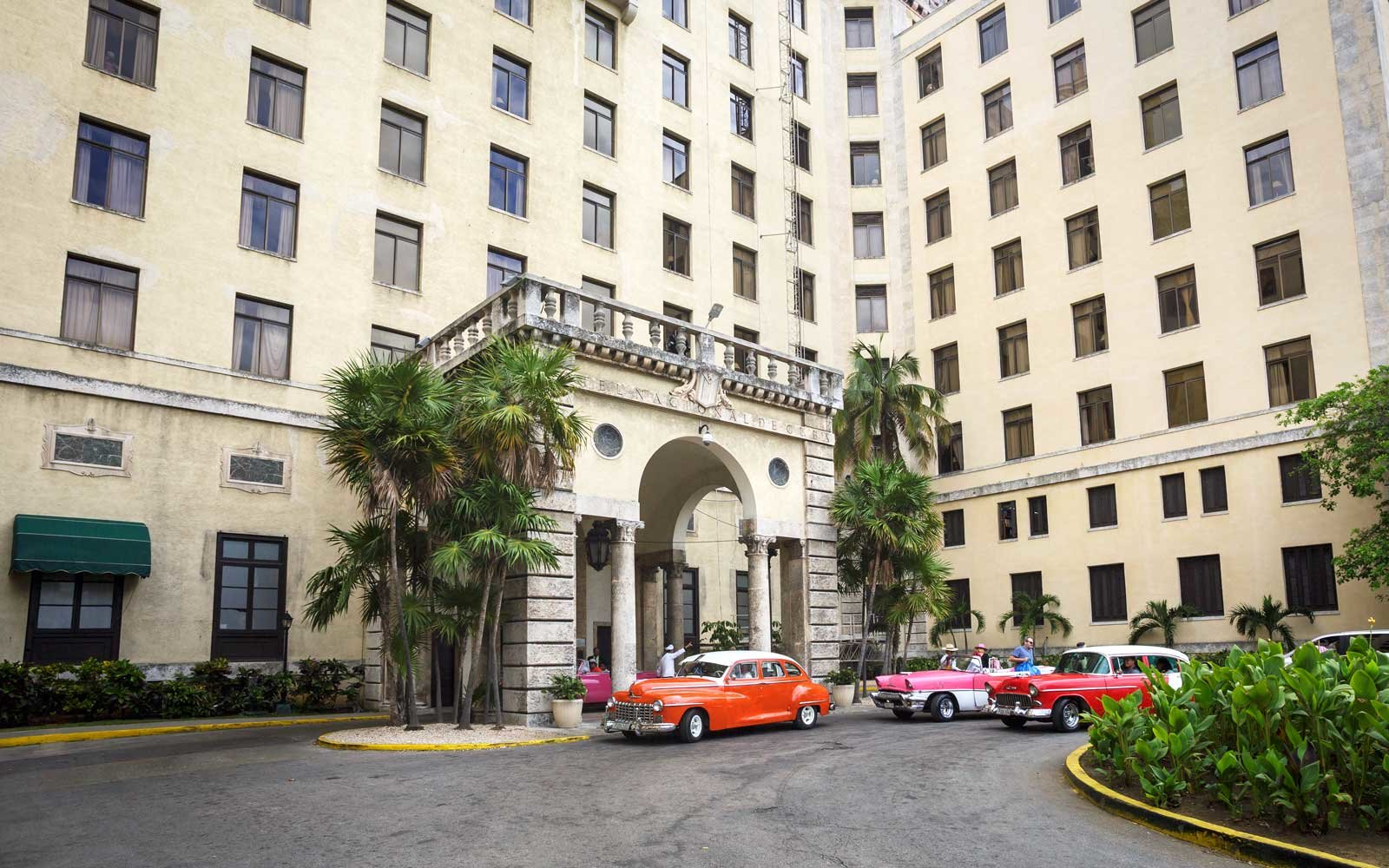 Colorful cars in front of the Hotel Nacional de Cuba
