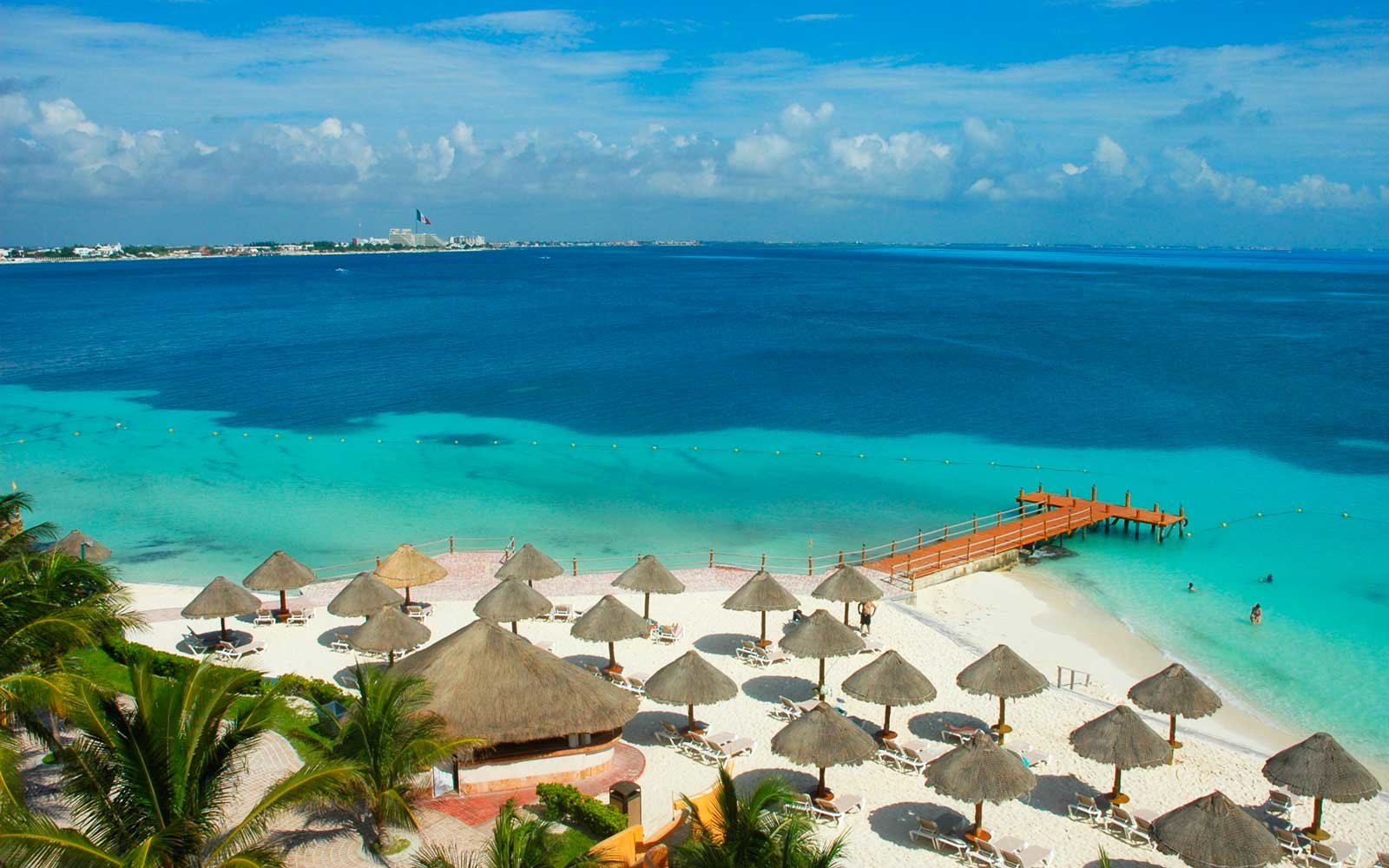 Beach chairs an umbrellas in Cancun, Mexico