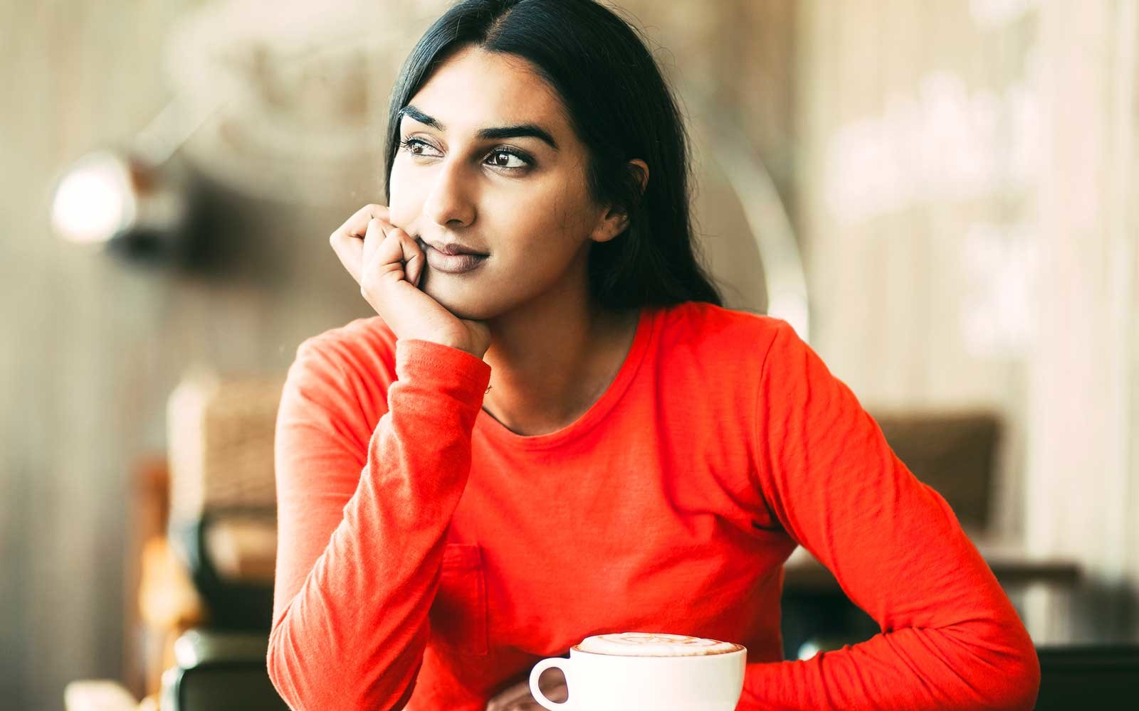 Girl ponders with latte