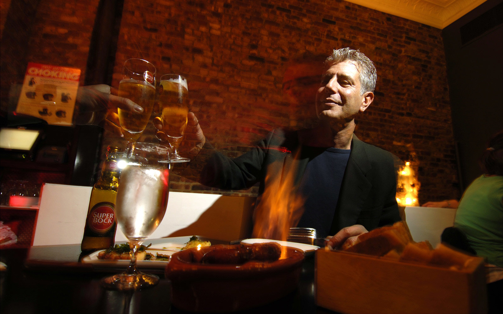 Chef Anthony Bourdain has a drink at Tintol restaurant in Ti
