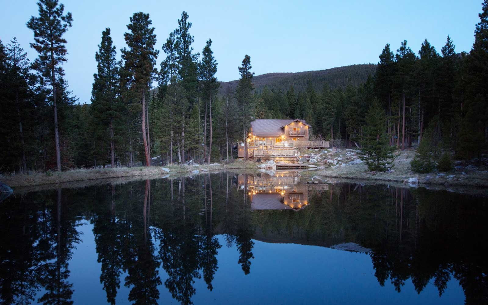 Night view of a cabin at Triple Creek Ranch