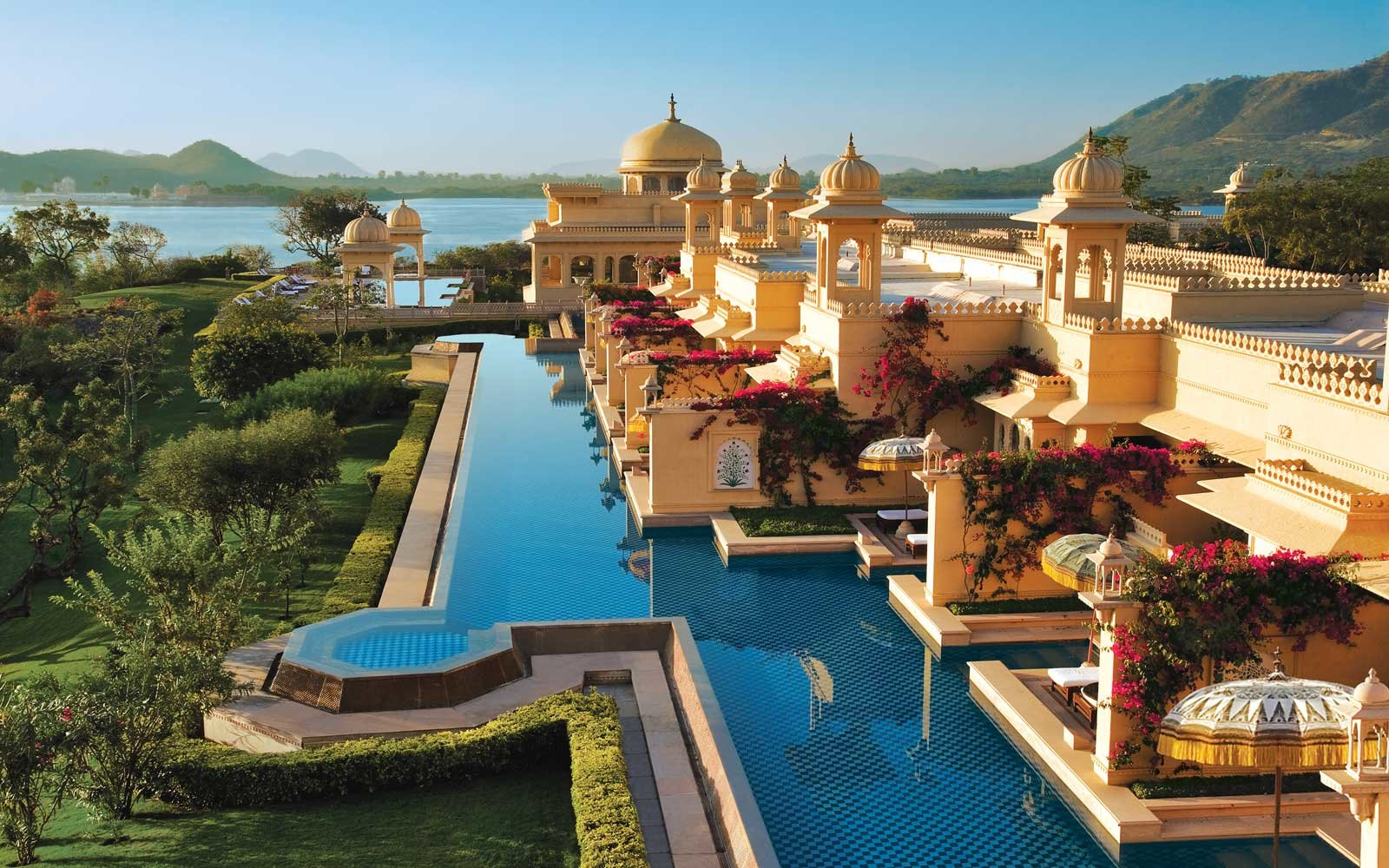 Sunrise over the deluxe rooms with semi private pool at the ultra luxurious Udaivilas Oberoi Hotel. Udaipur.