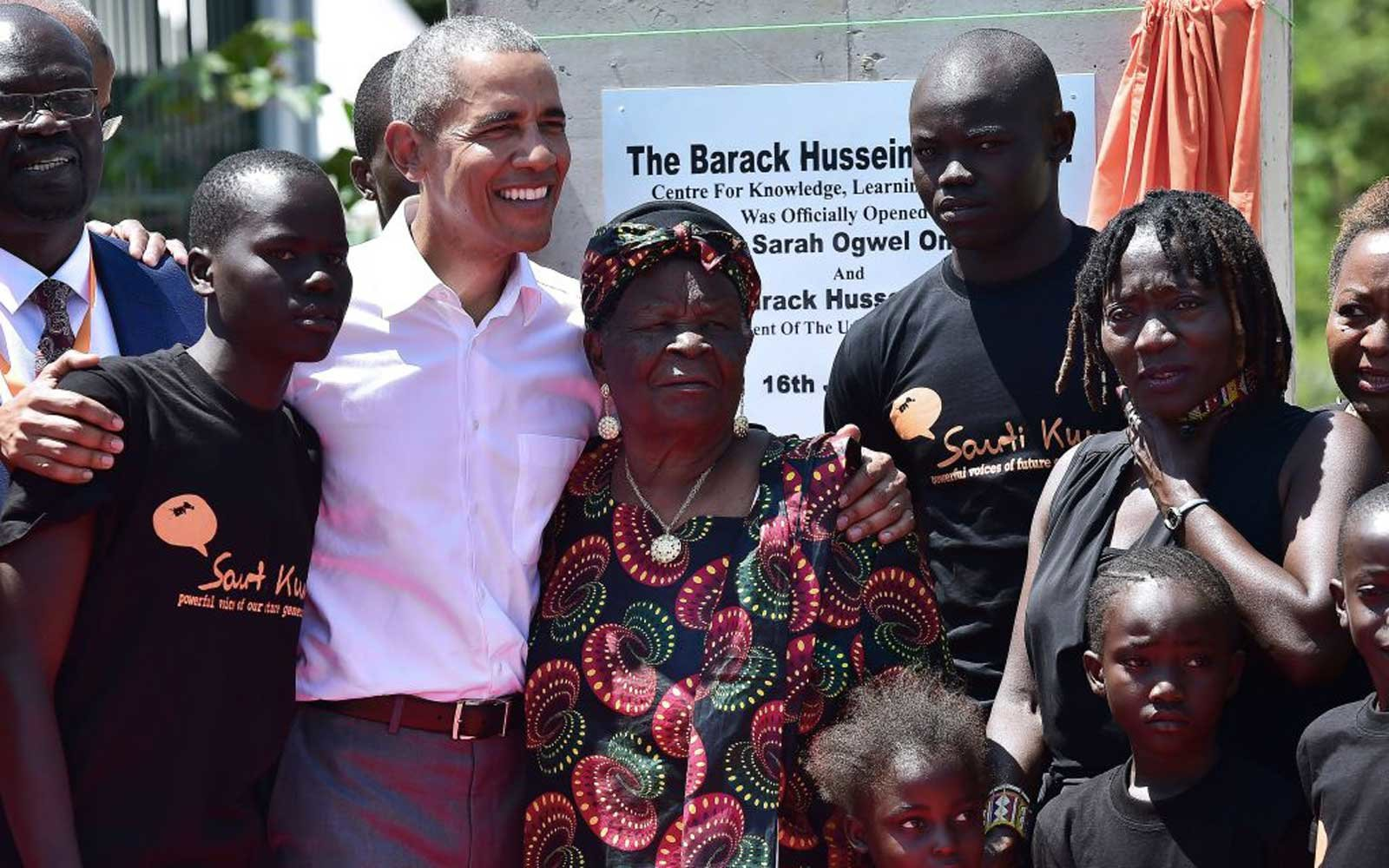 Former US President, Barack Obama (C) with his step-grandmother Sarah (2R) and half-sister, Auma (L) arrive to unveil a plaque on July 16, 2018 during the opening of the Sauti Kuu Resource Centre, founded by his half-sister, Auma Obama at Kogelo in Siaya