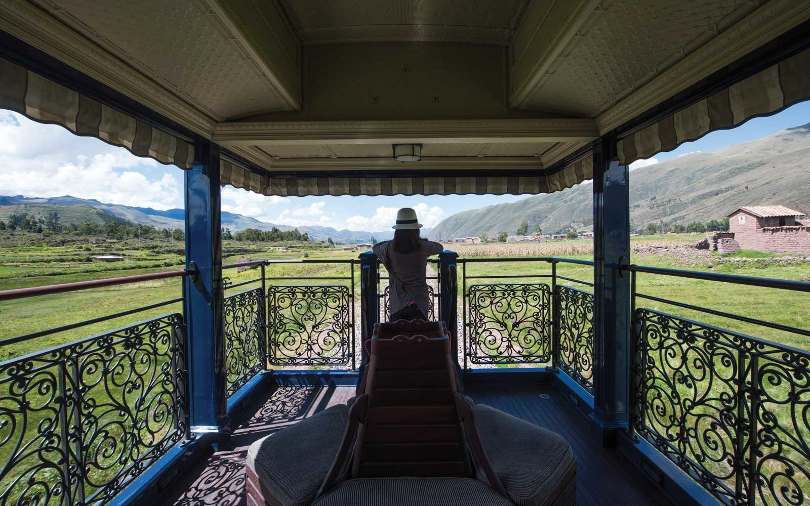 A passenger in the observation car as South America's first luxury sleeper train, Belmond Andean Explorer, passes through the Cusco region of Peru, during its journey between Arequipa, Lake Titicaca and Cusco.