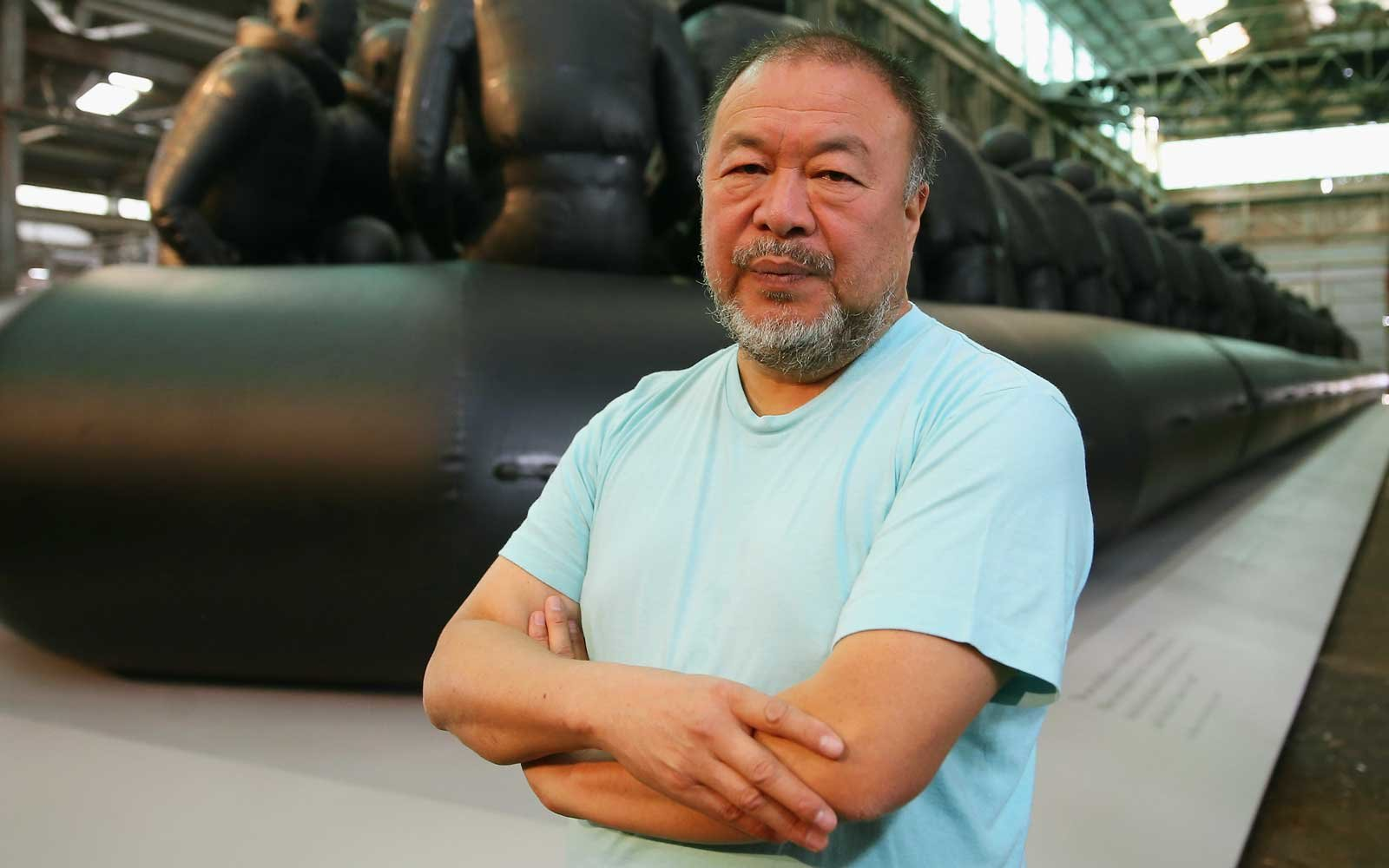 Ai Weiwei poses in front of his work 'Law of the Journey' on March 12, 2018 in Sydney, Australia