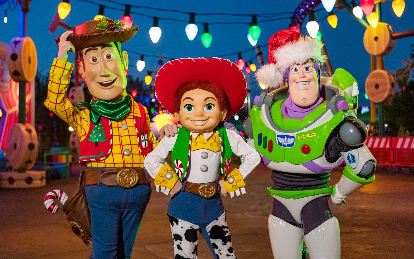 Characters at Toy Story Land dressed up for Christmas
