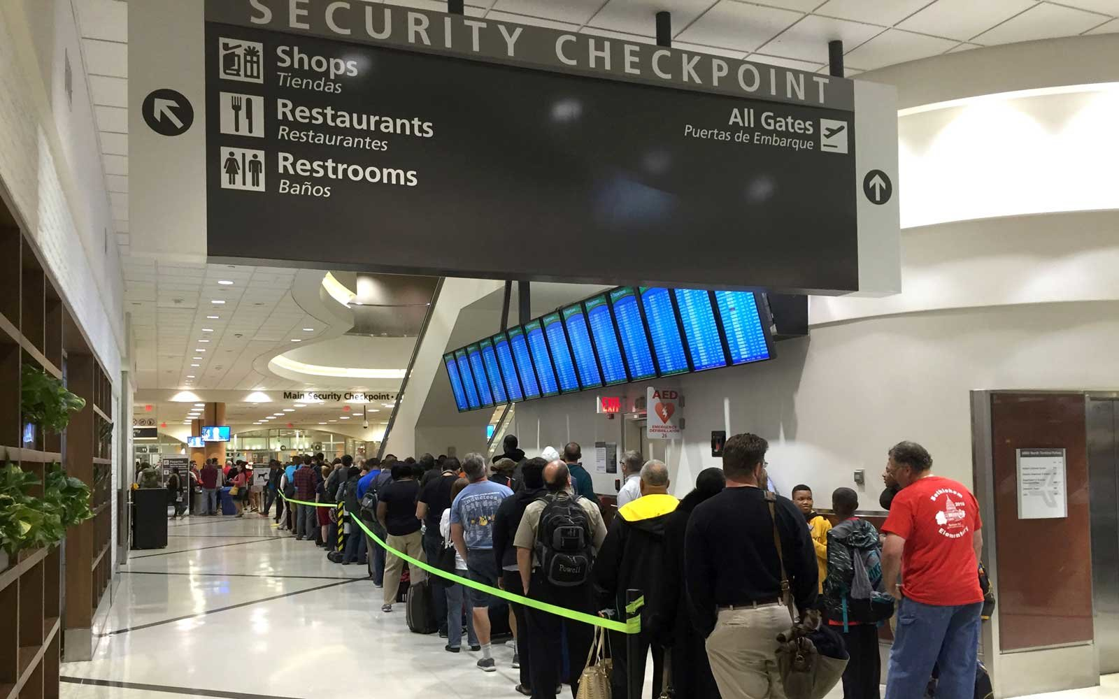 Passengers wait to go through security at the north terminal of the Hartsfield Jackson Atlanta International Airport in Atlanta, Georgia on May 17, 2016.