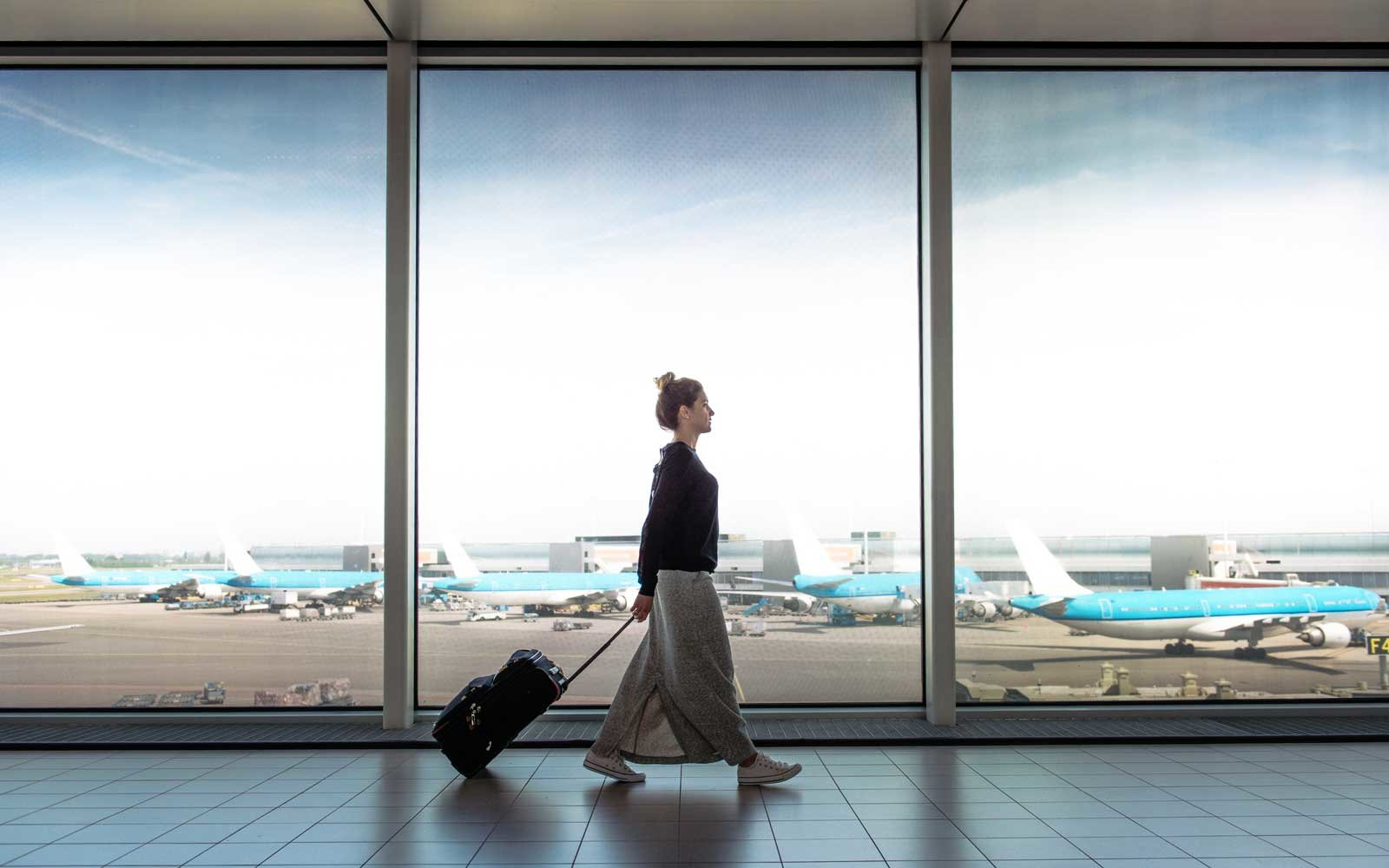 Woman at airport with Luggage