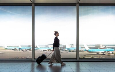 3090fa64015 Woman at airport with Luggage. Getty Images. Finding the best luggage for international  travel ...