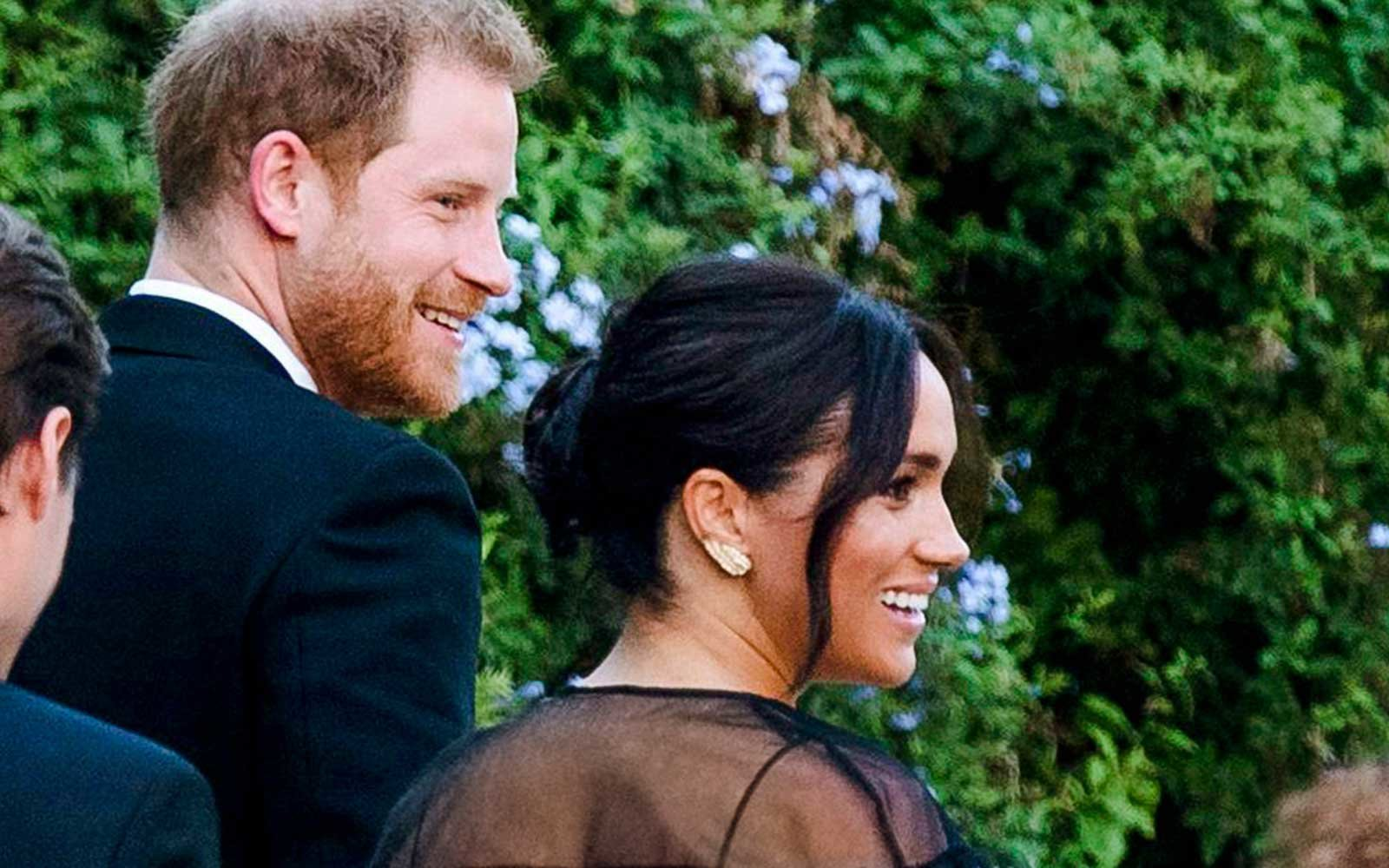 Britain's Prince Harry and his wife Meghan, Duchess of Sussex arrive to the wedding of Misha Nonoo and Michael Hess in Rome