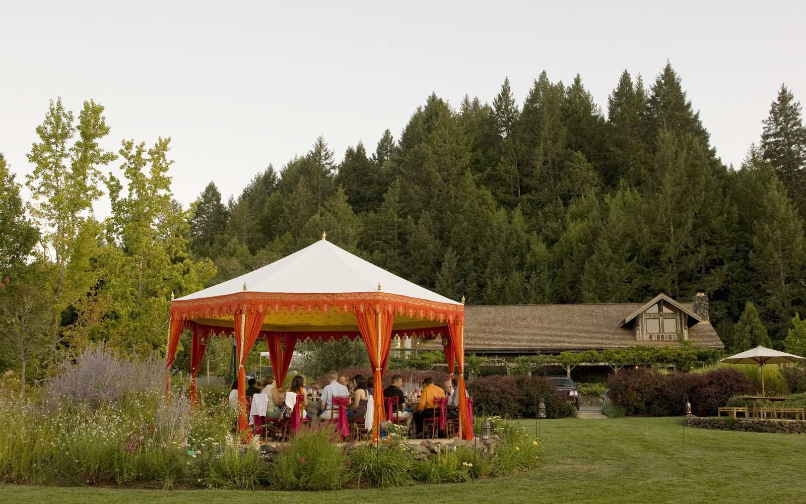 Guests share an intimate evening on the lawn at Lambert Bridge Winery
