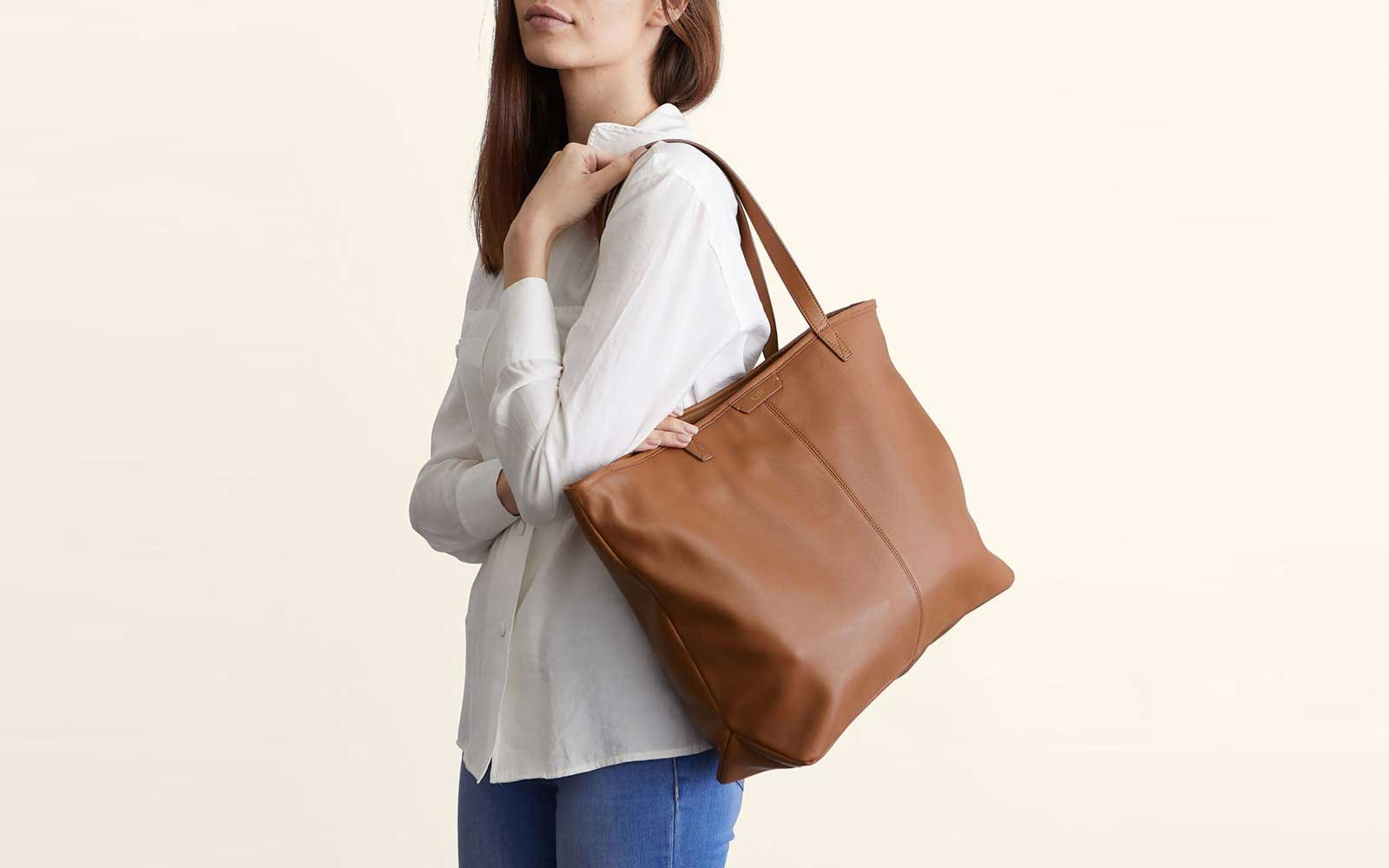 Woman Holding Tan Leather Tote