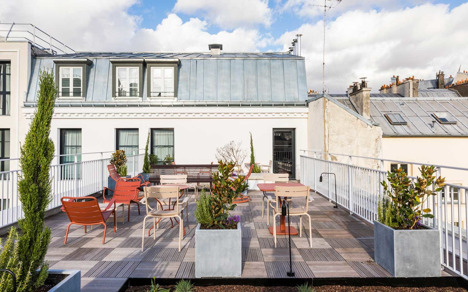 Rooftop seating at Le Grand Quartier Hotel in Paris