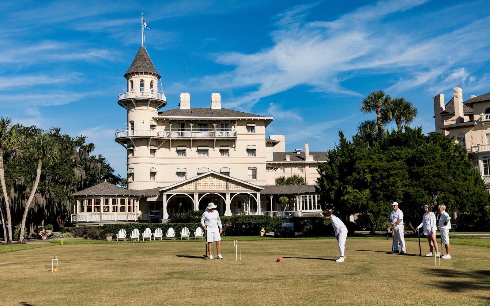 People dressed in all white playing croquet on the lawn of the Jekyll Island Club Resort