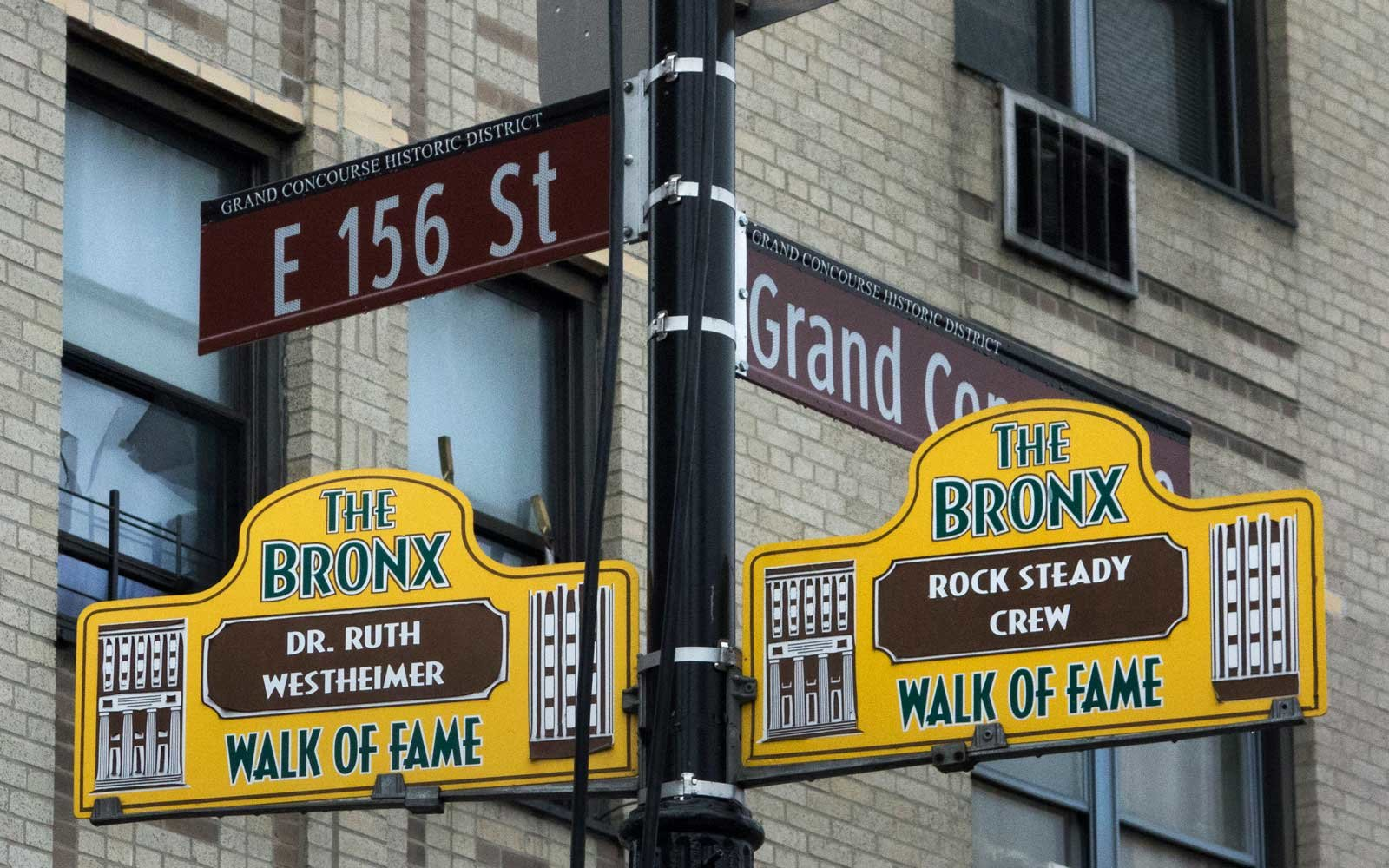 Signs honoring Hip-Hop pioneers Rock Steady Crew and US sex therapist Dr. Ruth Westheimer hang from a lamp post as part of the Bronx Walk of Fame in the Bronx on March 7, 2017 in New York.