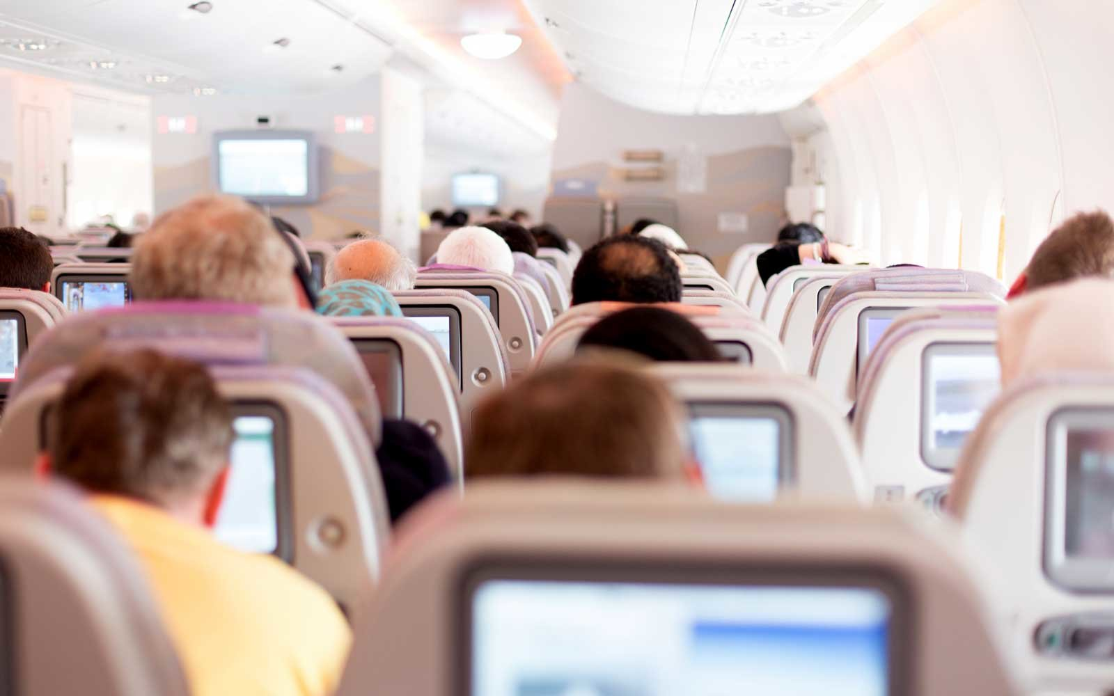 Why You Should Always Move Over If There's an Empty Seat in Your Row on an Airplane