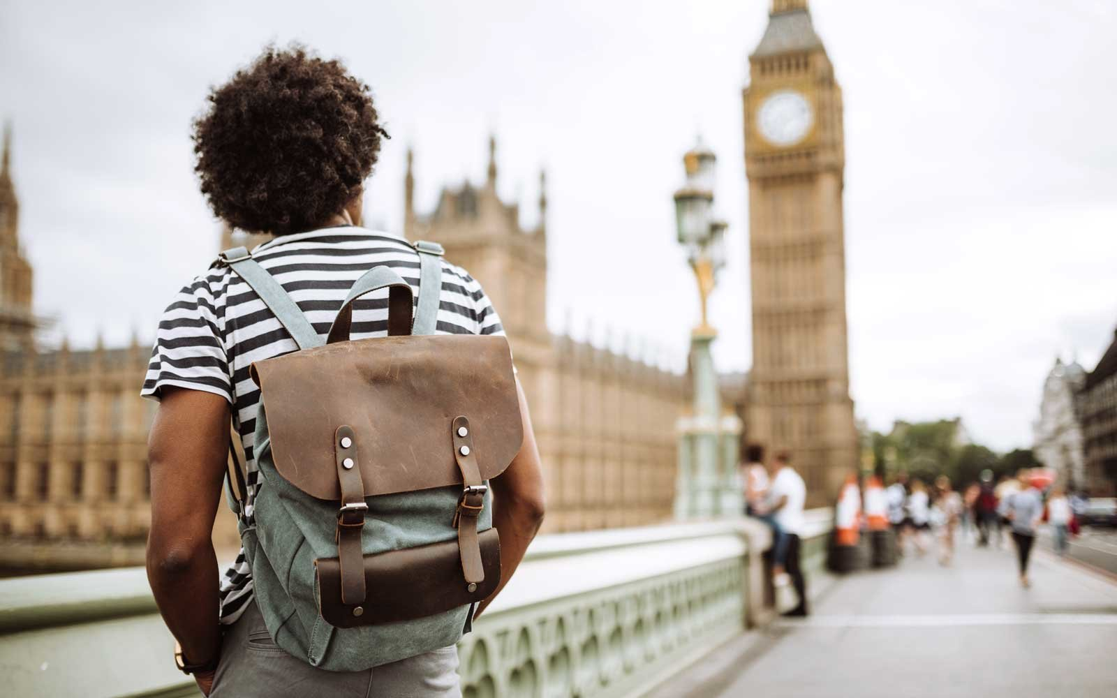 A tourist in London looking at Old Ben.