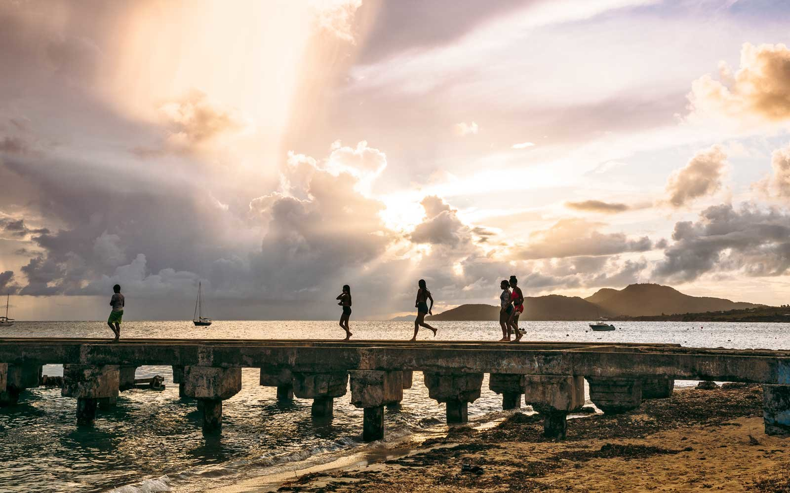 Children running on the main pier in Vieques, Puerto Rico