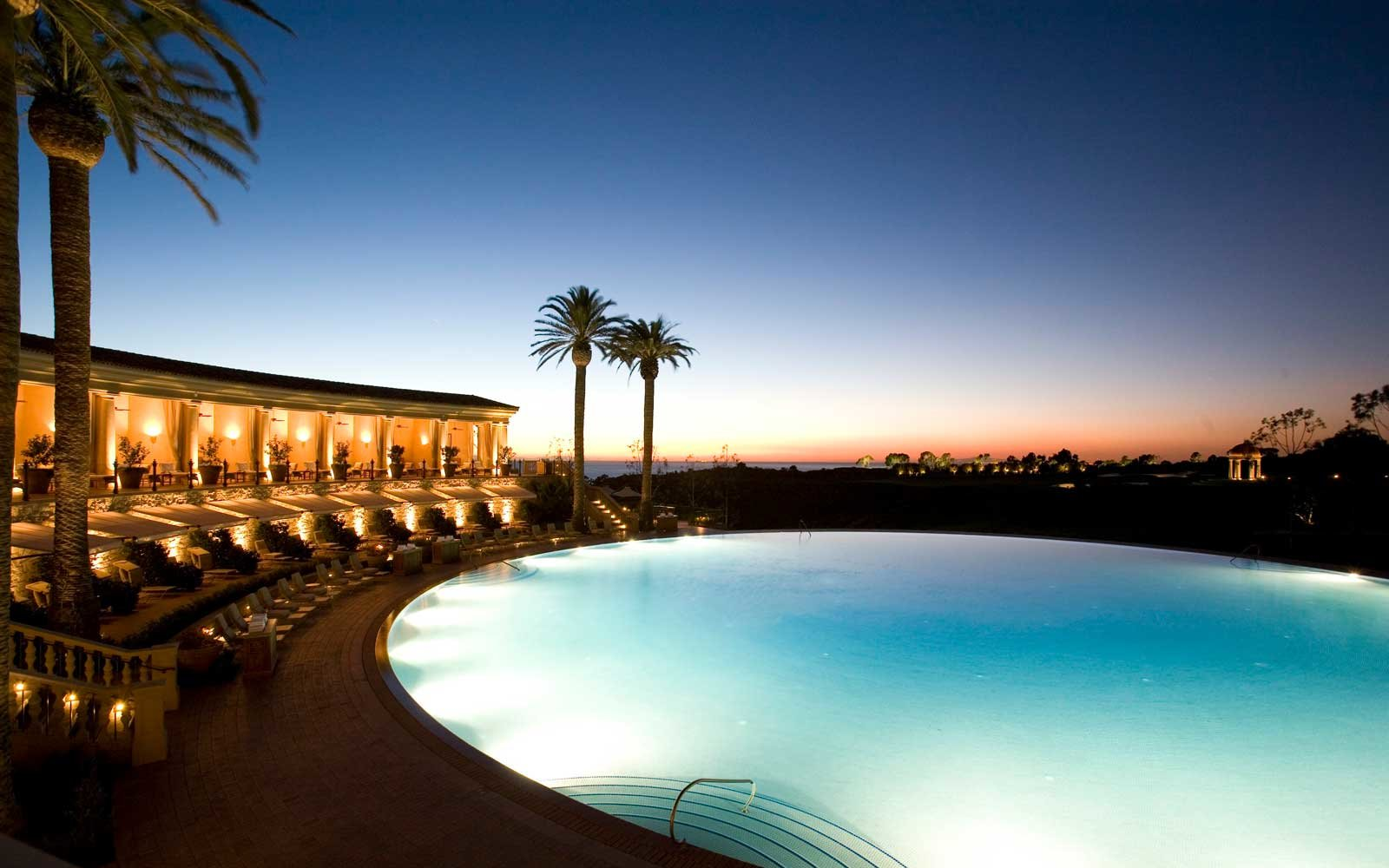 Nighttime view of the pool at Pelican Hill resort in California