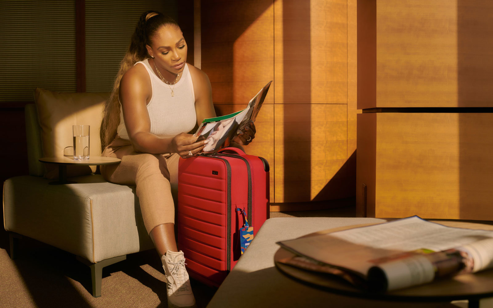 Serena Williams with Red Away Suitcase