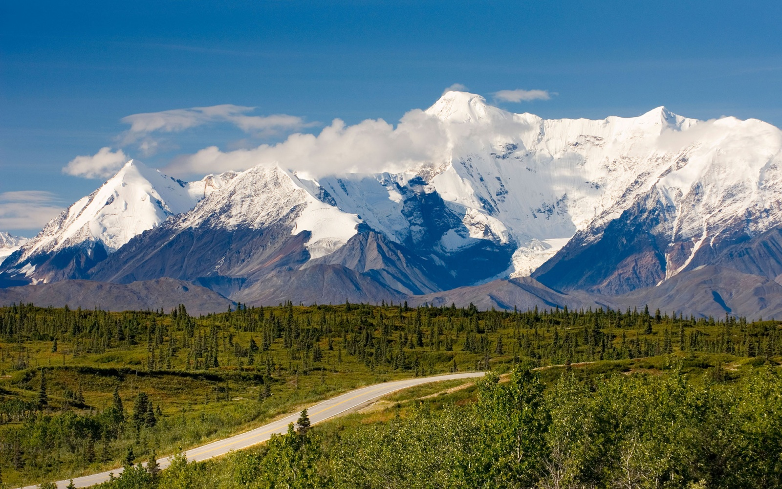 road to Anchorage to Valdez along snow-capped mountains, AK