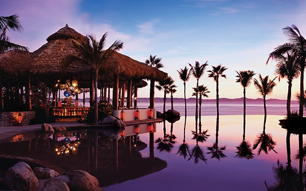 infinity pool at sunset at One&Only Palmilla, Los Cabos Mexico
