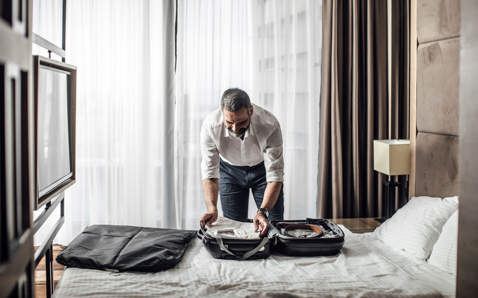 Man Packing a Garment Bag