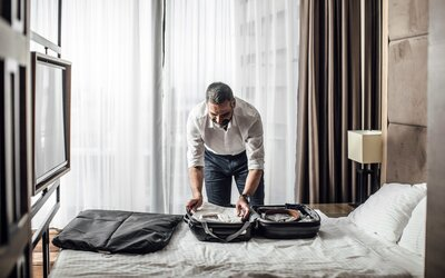 0878f4923c The Best Garment Bags for Travel | Travel + Leisure