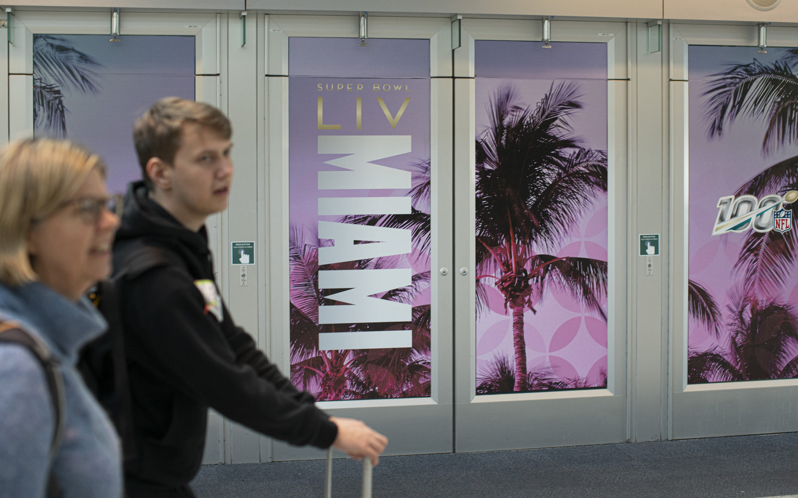 People arrive at Miami International Airport